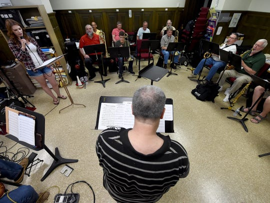 Tom McLaughlin, music director for the Unforgettable Big Band, directs a rehearsal at the First Presbyterian Church of York on April 11, 2017.
