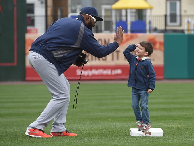 Revolution infielder Joel Guzman high fives 4-year-old