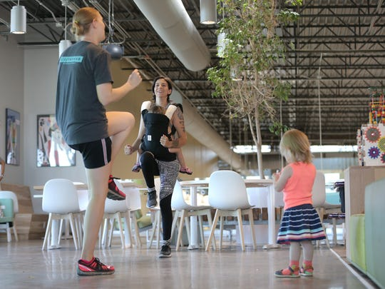Ashley Kilday, center, exercises with Kristyn Ingram, left, and their children Wednesday at the Whole Foods in west El Paso.