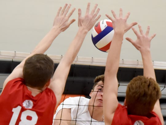 Spring Grove's Aaron Gunarich spikes the ball during a match against Neshaminy during the Bobcat Invitational in April.