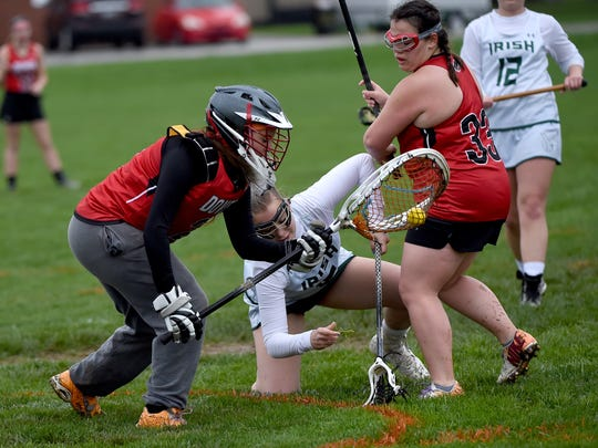 Action during the York Catholic girls Lacrosse team's defeat of Dover 16-5 on Tuesday, April 25, 2017.