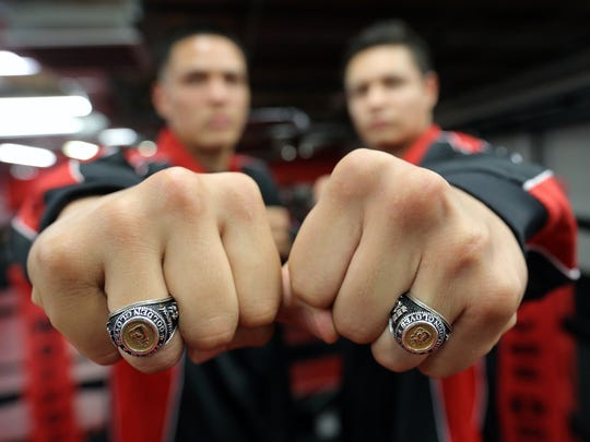 Jorge Tovar, left, and Victor Aranda show their Golden Gloves State Champion rings before heading to the national tournament.
