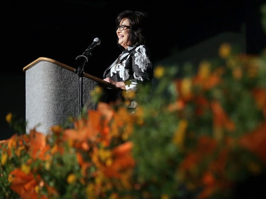 The YWCA Benefactress of the Year Rosa Santana asks those in attendance at the 24th Annual Women's Luncheon to give to the organization which helps women succeed.