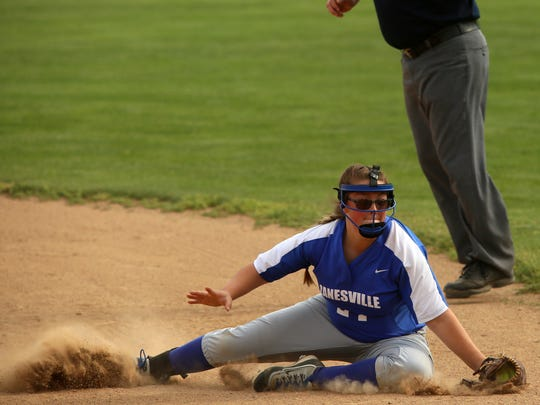 Zanesville's Erin Lee stops a ball near first base