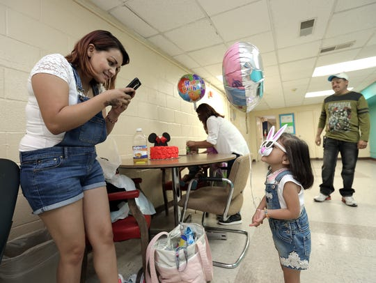 Paola Marquez takes a photo of her daughter, Stephanie,
