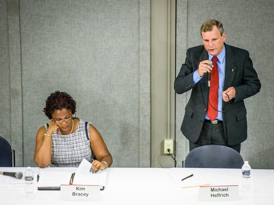 York City Council President and mayoral candidate Michael Helfrich speaks while participating in a forum with Mayor Kim Bracey at a recent candidates night event sponsored by the Alliance of Neighborhood Associations.