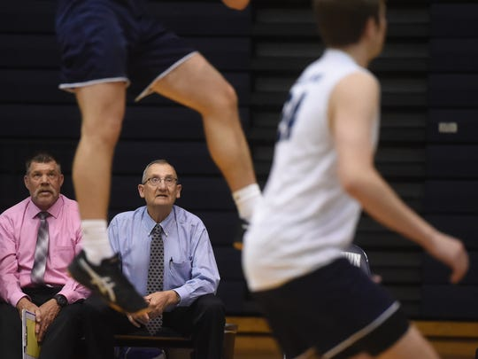 Dallastown coach Tom Beakler, right, eyes up the action