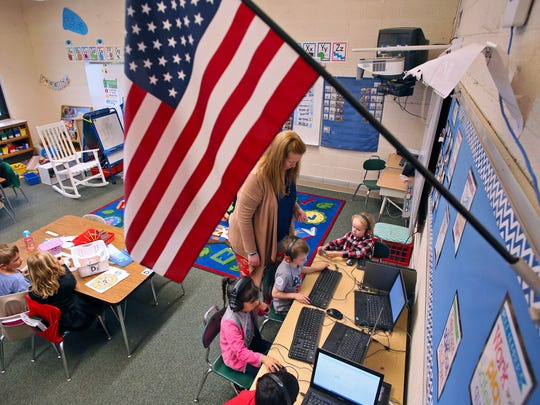 Amanda Webb, a kindergarten teacher at Alexandria Primary School, works with students Wednesday afternoon Ñ the day after the district's second failed attempt to pass a levy to build a new school.