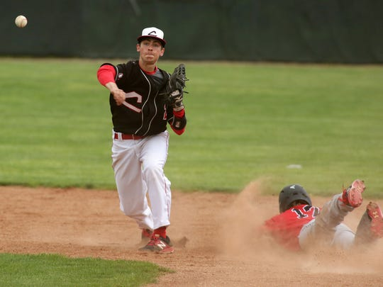 Coshocton sophomore Griffin Mason attempts a double play Tuesday during the team's 5-3 loss to Tusky Valley.