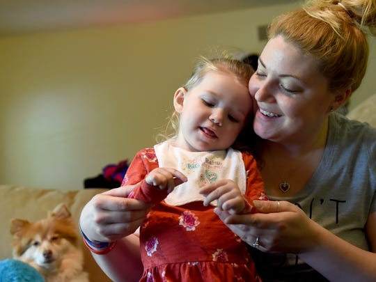 """I want to put as much fun into whatever time I have with her,"" says Mindy Hoffman, right, of her daughter Ruby, 2, who is living with the rare brain disease H-ABC, or Hypomyelination with atrophy of basal ganglia and cerebellum. The duo can be seen here playing ""Wheels on the Bus"" in their West Manchester Township living room on Friday, May 12, 2017."