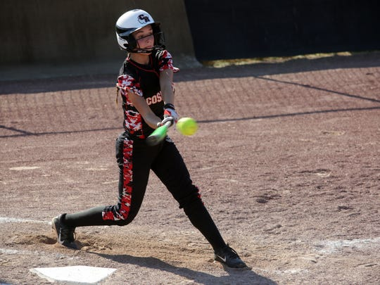 Coshocton senior Cassidy Cantrell hits a double Tuesday during the team's 15-1 loss to Edison.