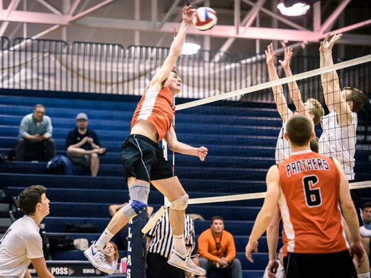 Central York's Cole Johnson (18) unleashes a kill attempt