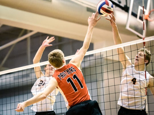 Northeastern's Wyatt Hughes (4) meets the attack of Central York's Braden Richard (11) in the YAIAA boys volleyball championship game at Dallastown on Tuesday, May 16, 2017.