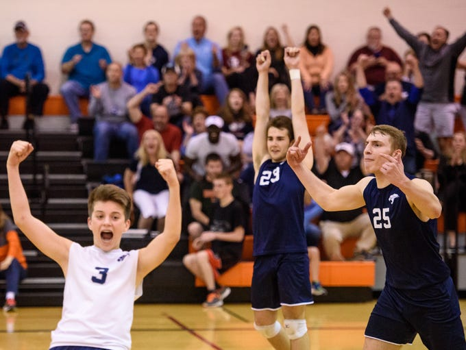 Dallastown celebrates a match win against Lower Dauphin