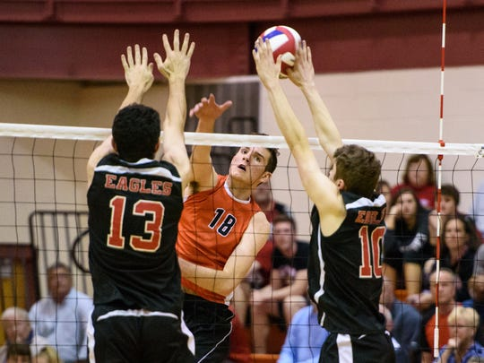 Central York's Cole Johnson (18) follows through on