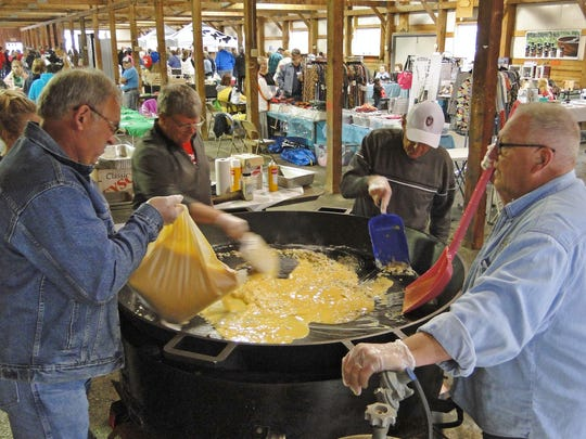 Volunteers cook a huge skillet of scrambled eggs for visitors at the Jefferson County Breakfast on the Farm event.