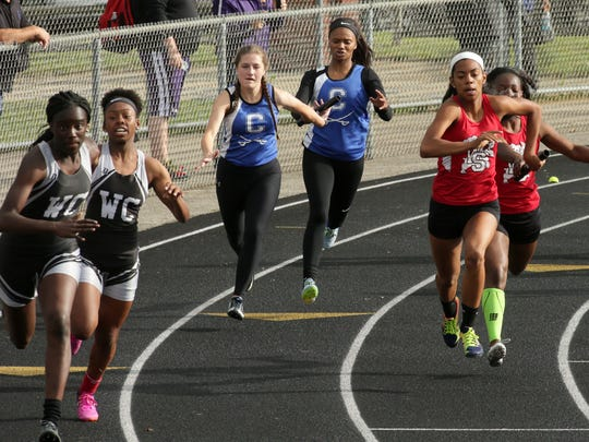 Chillicothe senior Emma Lanning takes the baton from junior Jasmine Jackson in the 4x100 relay Wednesday during the Division I regional track meet.