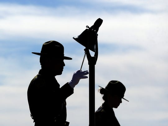 U.S. Border Patrol Agents from the El Paso Sector read the names of the 124 agents killed in the line of duty since 1924 and ring a bell during the Honor Roll Call ceremony in El Paso in May.