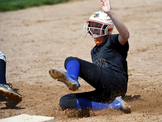 Kennard-Dale's Jaedyn McKeon slides into third during