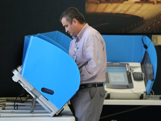 Voter Martin Torres casts his ballot during a recent election.