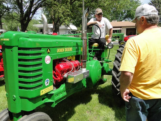 Mike Mudek's John Deere tractor stood out among all