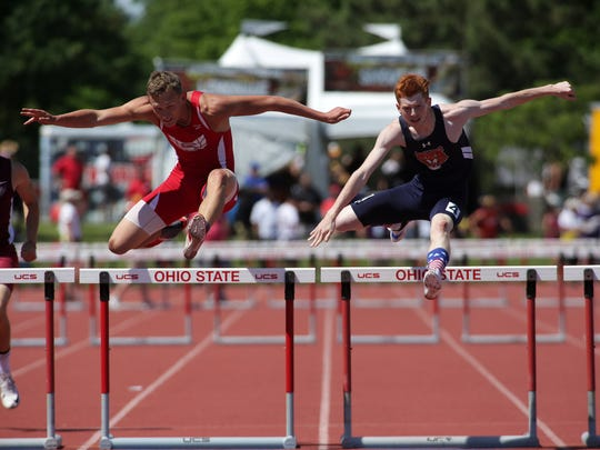 Sheridan's Ethan Tabor, left, and Galion's Colin McCullough compete in the 300 hurdles Friday during the Div. II State Track and Field Championships.