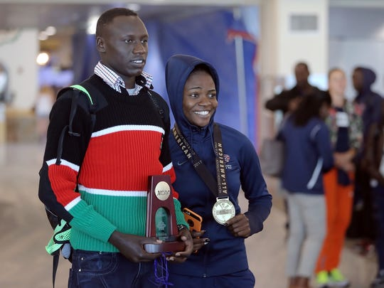 UTEP's Emmanuel Korir and Tobi Amusan show off their medals and trophies after winning national titles at the NCAA Track and Field Championships in Oregon. Korir won in the 800-meter run and Amusan in the 100-meter hurdles.