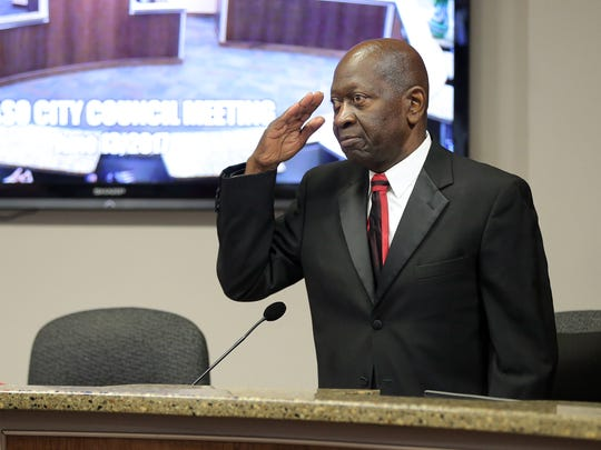 """El Paso city Rep. Carl Robinson salutes during his final council meeting and says, """"City Rep. 4, out."""""""