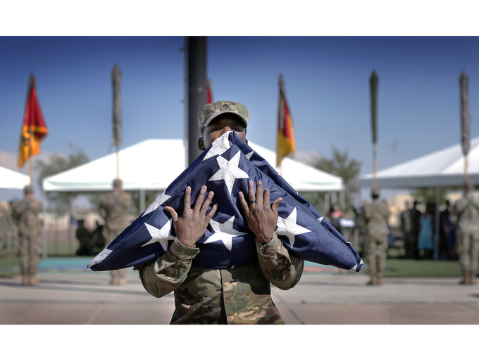 The 1st Armored Division cased their flag Wednesday
