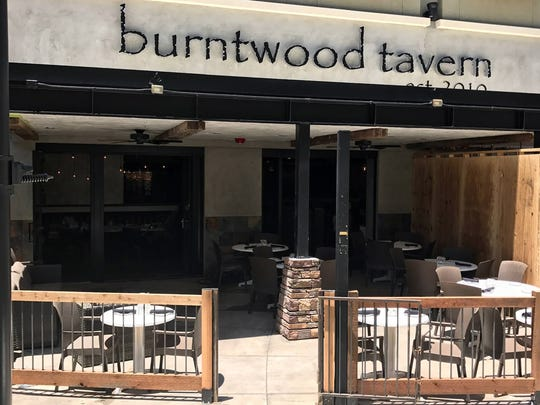 Part of the patio at Burntwood Tavern, now open at Mercato in North Naples.