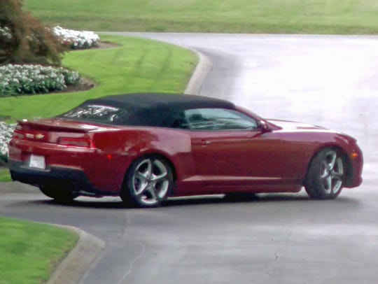 The suspects fled the scene in a red Camaro convertible.
