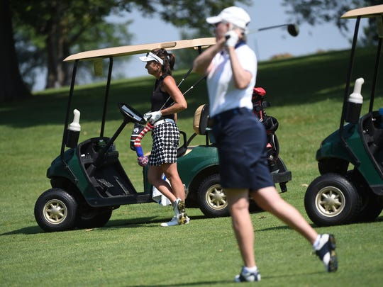 Amy Kennedy, left, looks on as Connie Shorb, hits a shot during the York County Amateur Golf Association Championship at Cool Creek Golf Club on Thursday, June 22, 2017.