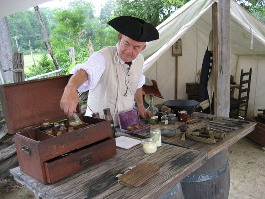 A Continental Army surgeon in the surgeon's tent at