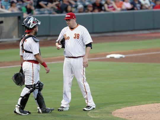 San Diego Padre pitcher Trevor Cahill who is in El Paso on a rehab assignment talks with catcher Tony Cruz Wednesday.