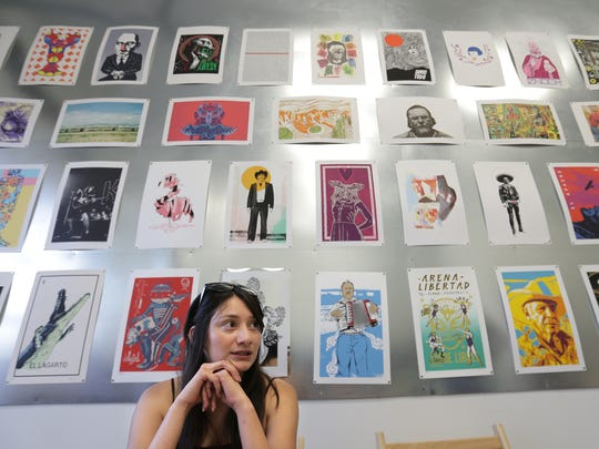 Victoria Martinez of the University of Texas at El Paso National Honors Society works a booth at the Last Thursdays Gallery El Paso Crawl and Art Market on June 29.