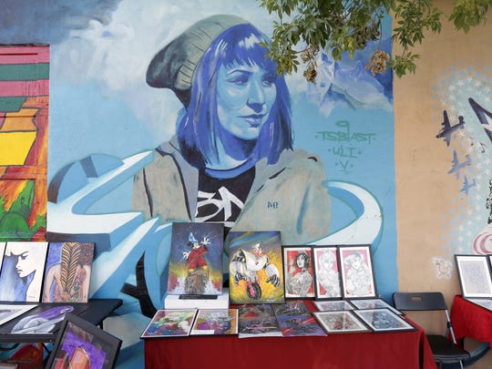 Artists sell their work outside The Rock House Cafe & Gallery at 400 W. Overland Ave. during the Last Thursdays El Paso Gallery Crawl and Art Market on June 29.
