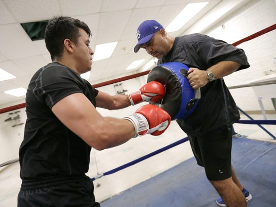 Former professional boxer Herman Delgado trains fighters at the Armijo Recreation Center.