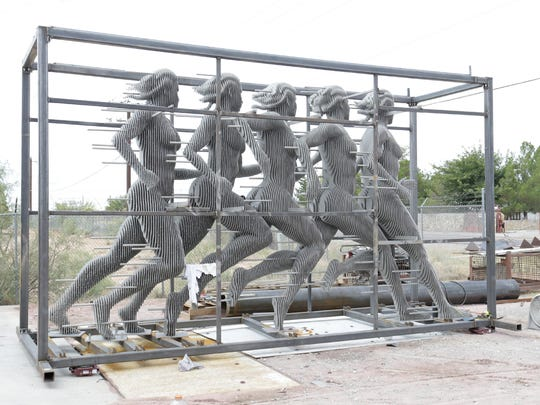 Once in place, the frame will be removed from the sculpture.