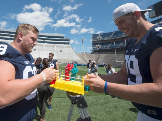 Penn State OL Hunter Kelly, left, and Charlie Shuman,