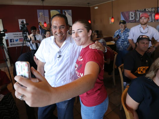 Gabee Lepore takes a photo with U.S. Rep. Will Hurd during his town hall Sunday at a Dairy Queen in El Paso's Lower Valley.
