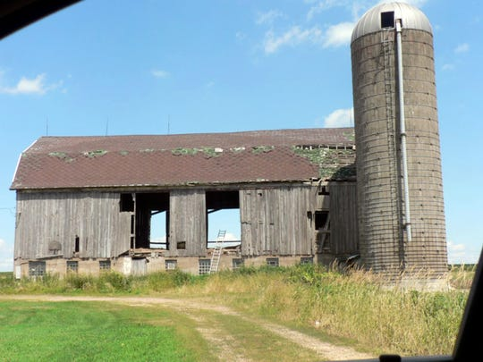 Many vacant dairy barns line rural roads. There are