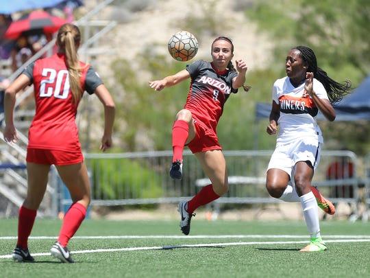 UTEP's Lauren Crenshaw, right, defends Arizona's Gabi Stoian during their exhibition match Sunday at University Field.