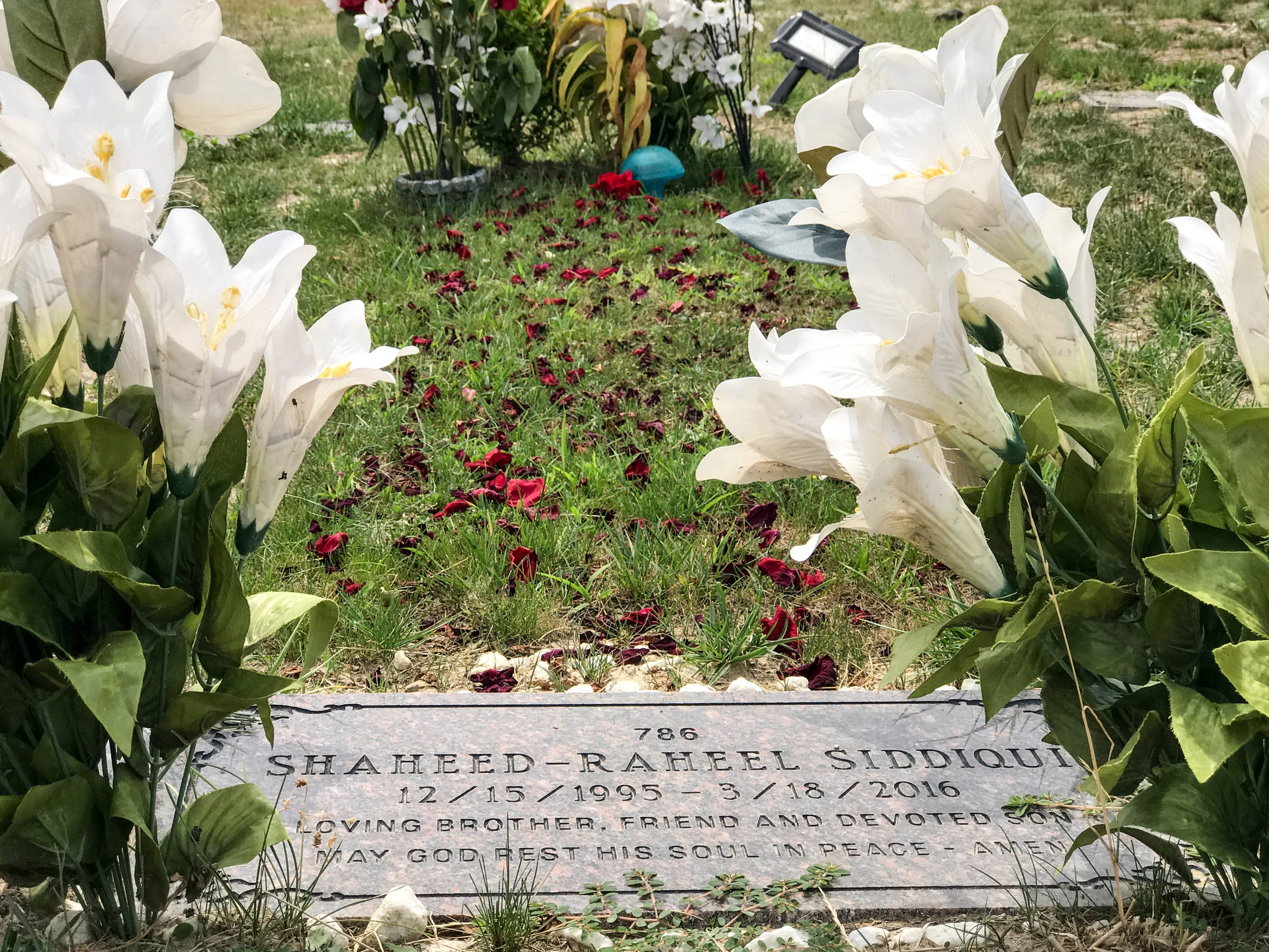 The gravesite of Raheel Siddiqui is seen at Woodmere Cemetary in Detroit.  Siddiqui died during Marine training at Parris Island in March of 2016.