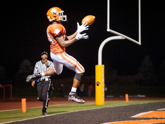 Central York's Tim Sturgis (13) leaps for a pass last