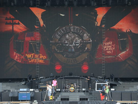 Stage hands sound check at the Sun Bowl for Wednesday's