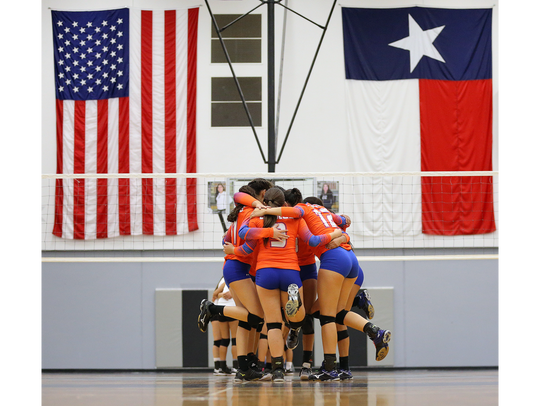 Canutillo huddles at mid court Tuesday before their