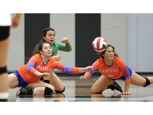A trio of Canutillo volleyball players brace for impact as they go for the same dig Tuesday night against Horizon.