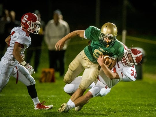 In this file photo, York Catholic's Kyle Dormer fights