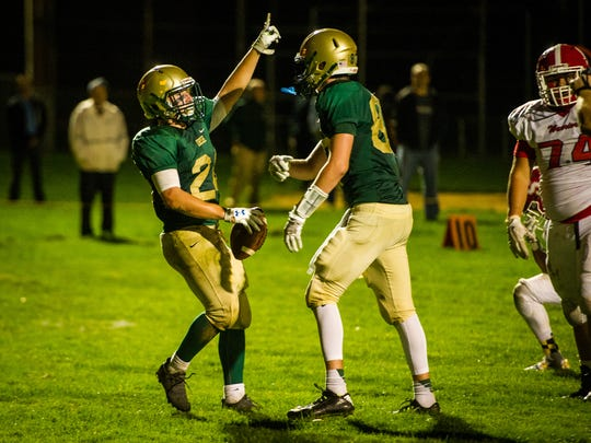 York Catholic's Andrew Snelbaker (24) celebrates a touchdown with Riley Brennan (87) against Susquehannock in a YAIAA football game on Friday, Sept. 8, 2017. York Catholic won 27-17.