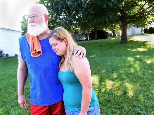 """""""I just saw him laying there and I thought, 'Oh my God, that's just a kid,'"""" said Tia Gilbert, right, being consoled by neighbor Jim Eiler on Saturday, Sept. 23, 2017. The Dover township duo were two of the people first on the scene after 13-year-old Matthew Gowen died after being struck by a vehicle on Thursday."""